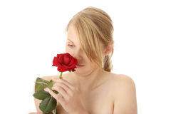 Beautiful young woman with red rose. Isolated Royalty Free Stock Images