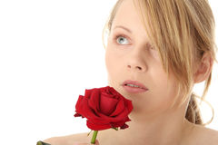 Beautiful young woman with red rose. Isolated Stock Image