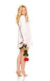 Beautiful Young Woman With Red Rose. Stands on tiptoe Royalty Free Stock Photos