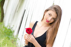 Beautiful young woman and red rose Stock Image