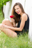 Beautiful young woman and red rose Royalty Free Stock Image