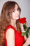 Beautiful young woman with a red rose Stock Image