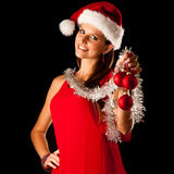 Beautiful young woman in red santa dress isolated over black bac Royalty Free Stock Photo
