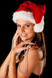 Beautiful young woman in red santa dress isolated over black bac Stock Photos