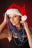 Beautiful young woman in red santa dress isolated over black bac Royalty Free Stock Photography