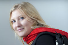 Beautiful young woman with red scarf Stock Photography