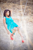 Beautiful young woman in red shoes Stock Image