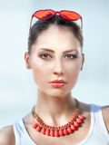 Beautiful young woman with red sunglasses stock photography
