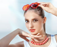 Beautiful young woman with red sunglasses royalty free stock images