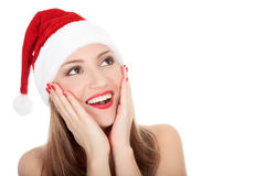 Beautiful young woman in red wearing santa hat. Stock Photo