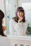 Beautiful young woman reflection in mirror Stock Photography