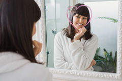 Beautiful young woman reflection in mirror Stock Image