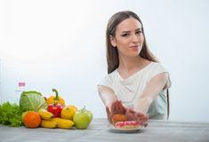 Beautiful young woman is refusing to eat unhealthy Stock Photos