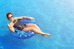 Woman relax on inflatable ring in sea water stock images