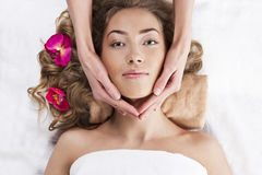 Beautiful young woman relaxed, in the spa salon Royalty Free Stock Images