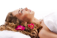 Beautiful young woman relaxed, in the spa salon Royalty Free Stock Image