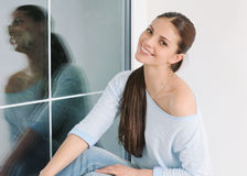 Beautiful young woman relaxin at home in comfy soft sweater. Beautiful young woman relaxin at home in comfy sweater, lifestyle concept Stock Photography