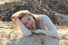 Beautiful young woman relaxing on the beach. In the autumn Royalty Free Stock Photo