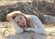 Beautiful young woman relaxing on the beach. In the autumn Royalty Free Stock Photography