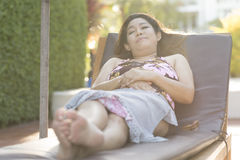 Beautiful young woman relaxing on beach chair Royalty Free Stock Photos