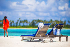 Beautiful young woman relaxing at beach chairs Royalty Free Stock Image