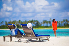 Beautiful young woman relaxing at beach chairs Stock Image