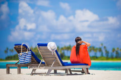 Beautiful young woman relaxing at beach loungers Royalty Free Stock Photography