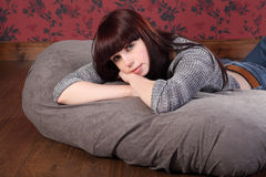 Beautiful young woman relaxing on bean bag Stock Photography