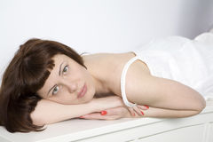 Beautiful young woman relaxing on bed Stock Photography