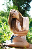 Beautiful young woman relaxing in garden Royalty Free Stock Photos