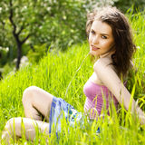 Beautiful young woman relaxing in the grass Royalty Free Stock Photo