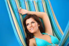 Beautiful Young Woman relaxing in hammock Stock Photo