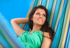 Beautiful Young Woman relaxing in hammock Stock Photography