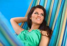 Beautiful Young Woman relaxing in hammock Stock Photography