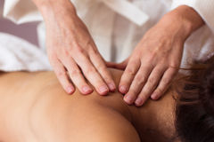 Beautiful young woman relaxing with hand massage at beauty spa Stock Images