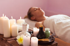 Beautiful young woman relaxing with hand massage at beauty spa Royalty Free Stock Photo
