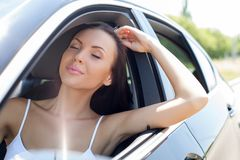 Beautiful young woman is relaxing in her transport Royalty Free Stock Image