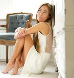Beautiful young woman relaxing at home Royalty Free Stock Photo