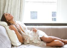 Beautiful young woman relaxing at home stock photo