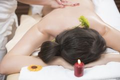 Beautiful young woman relaxing massage at beauty spa stock photo