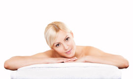 Beautiful young woman relaxing after massage. Spa royalty free stock images