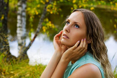 Beautiful young woman relaxing on nature. Royalty Free Stock Photo