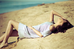 Beautiful young woman relaxing near the sea Royalty Free Stock Photo