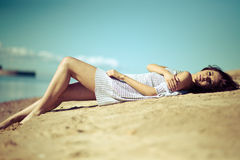 Beautiful young woman relaxing near the sea Stock Photography