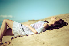 Beautiful young woman relaxing near the sea Royalty Free Stock Image