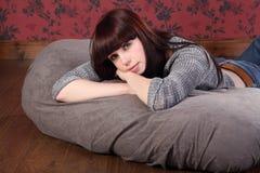 Beautiful Young Woman Relaxing On Bean Bag Stock Photography
