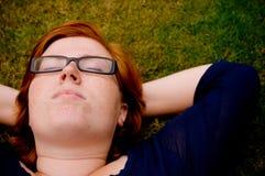 Beautiful young woman relaxing outside Stock Image