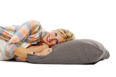 Beautiful young woman relaxing on pillow Stock Photography