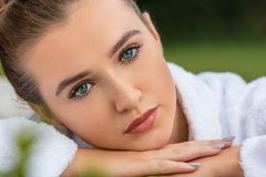 Beautiful Young Woman Relaxing in Robe at Health Spa Stock Image