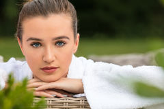Beautiful Young Woman Relaxing in Robe at Health Spa Royalty Free Stock Photography